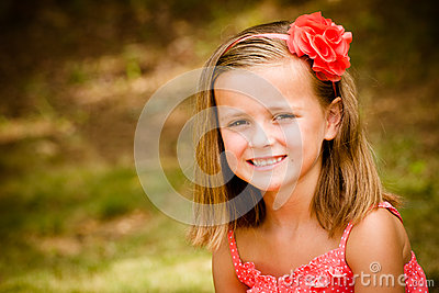 Summer child portrait of smiling pretty young girl