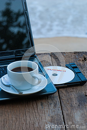 Summer concept with laptop and coffee cup