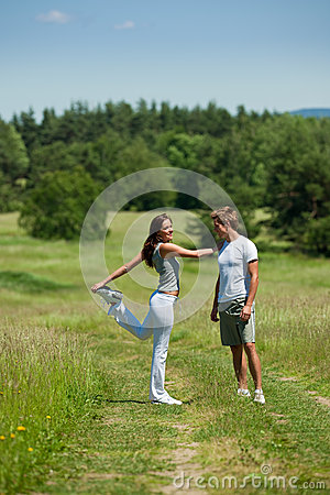 Summer - Couple stretching in a meadow
