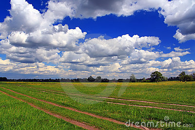 Summer field with clouds