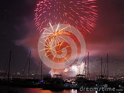 Summer fireworks over boats in harbor Editorial Photography