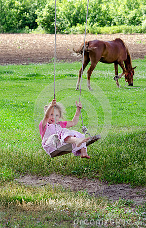Free Summer Fun, Girl On A Wood Swing Royalty Free Stock Photography - 74893147