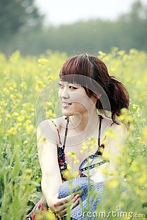 Summer girl in rape field.
