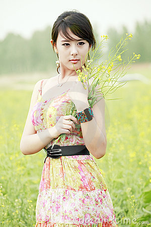 Summer girl in rape field.