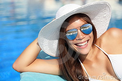 Summer girl smiling by pool