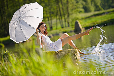 Summer - Happy romantic woman sitting by lake