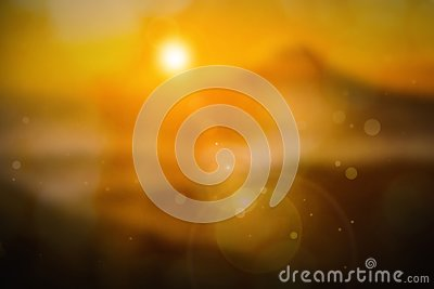 Summer holiday concept: sun light and abstract blur yellow background. Stock Photo