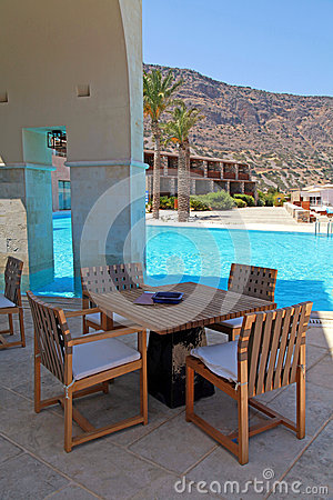 Summer hotel terrace with pool and outdoor furniture(Greece)