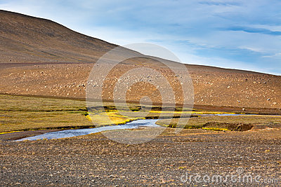 Iceland Landscape with River, Mountains and Bright Blue Sky