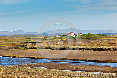 Iceland Landscape with River, Mountains and White Farmhouse
