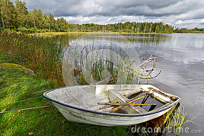 Summer lake in Sweden with boat