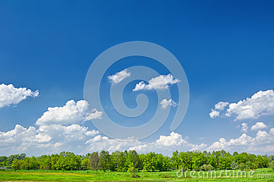 Summer landscape with clouds on the blue sky.