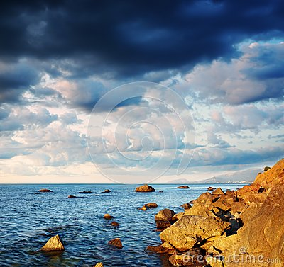 Summer landscape with the sea and the cloudy sky.