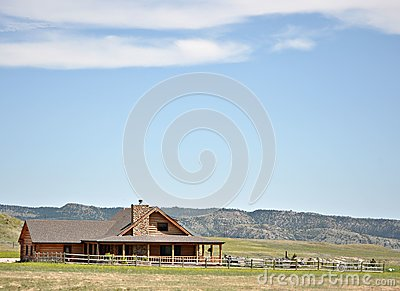 Summer log cabin and yard in the hills