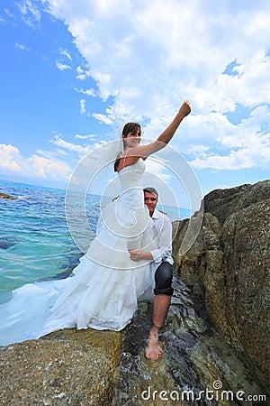 Summer love by the sea shore - couple portrait