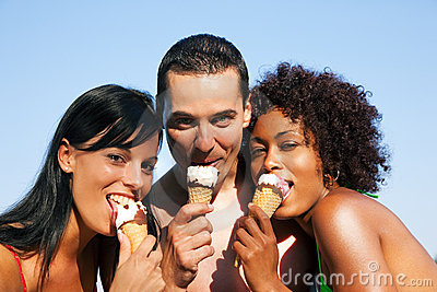 Summer - man and two women eating ice on beach