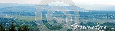 Summer misty morning mountain village panorama