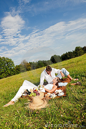 Summer picnic - Happy couple in meadow