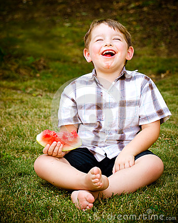 Summer portrait of  child eating watermelon