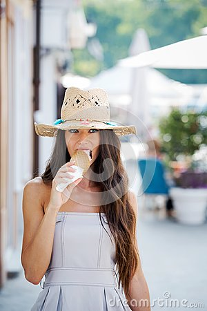 Free Summer Portrait Of Beautiful Woman With Ice Cream Outdoors Stock Photo - 117179580