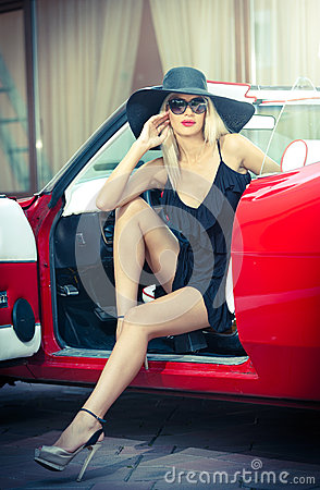 Free Summer Portrait Of Stylish Blonde Vintage Woman With Long Legs Posing Near Red Retro Car. Fashionable Attractive Fair Hair Female Royalty Free Stock Photo - 43978455