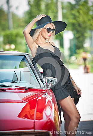 Free Summer Portrait Of Stylish Blonde Vintage Woman With Long Legs Posing Near Red Retro Car. Fashionable Attractive Fair Hair Female Royalty Free Stock Photos - 46294508