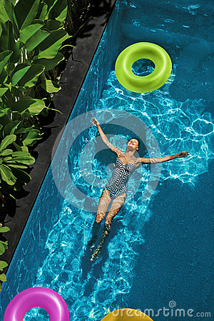 Free Summer Relax. Woman Floating, Swimming Pool Water. Summertime Holiday Royalty Free Stock Photo - 70251845