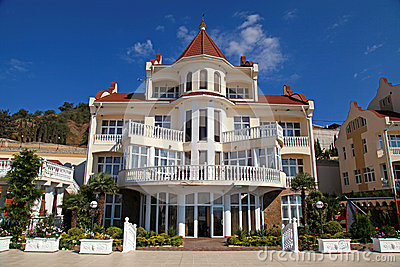 Summer resort villa with classical white balconies