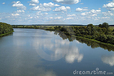Summer river  view with blue sky and clouds