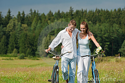 Summer - Romantic couple with bike in meadow
