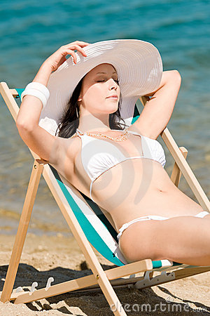 Summer slim woman sunbathing in bikini deckchair