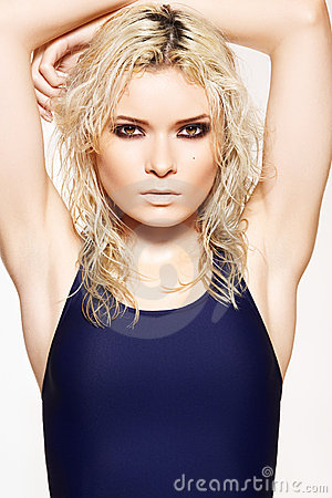 Summer style, make-up, wet hair. Woman in swimsuit