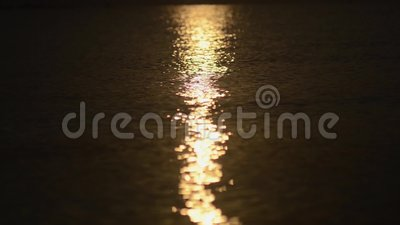 Summer sun reflection sparkles in the water by the sea shores stock footage