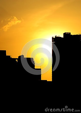 Summer Sunset with Silhouette of Buildings