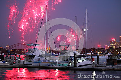 Boats at jetty with fireworks over harbor Editorial Photo