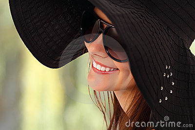 Summer teen girl cheerful in panama and sunglasses