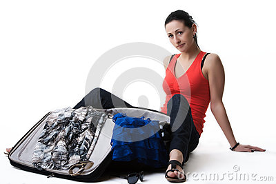 Worried woman next to her open suitcase