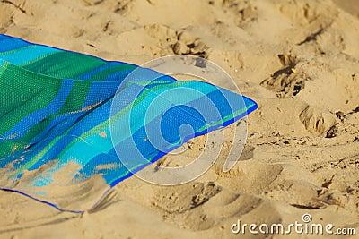 Summer vacation. Empty blue green mat on the beach