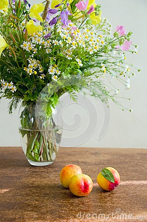 Summer wild flowers with peaches