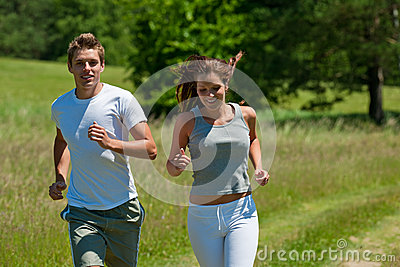 Summer - Young couple running in meadow