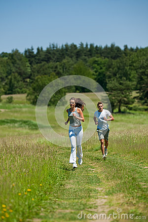 Summer - Young woman with headphones jogging