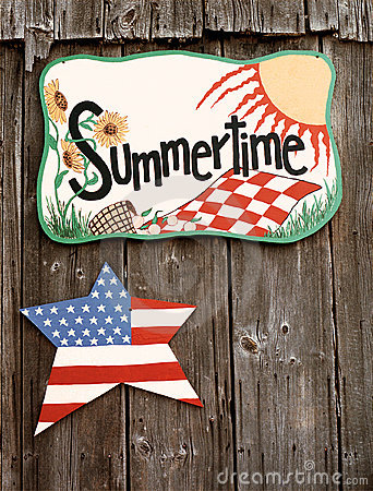 Summertime sign on barn wall