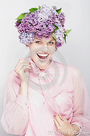 Summery picture. Girl with flowers and a big smile