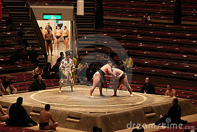 Sumo wrestlers practicing in empty arena Editorial Stock Photo
