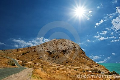 Sun above a mountain