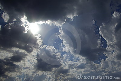 Sun appearance through dark clouds