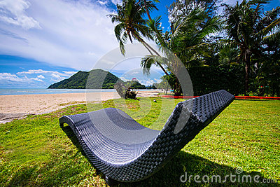 Sun bed on beautifull tropical beach in Thailand