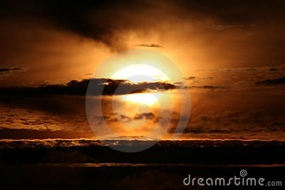 The Sun behind clouds