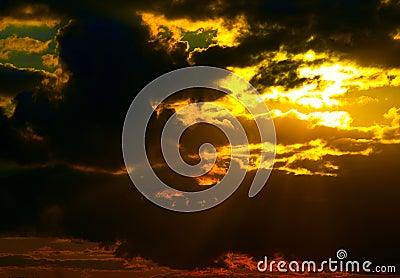 Sun behind storm-cloud