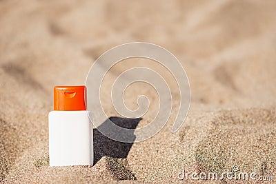 Sun block creme on sand